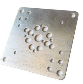 metal plate with holes punched in it by our turret punch press