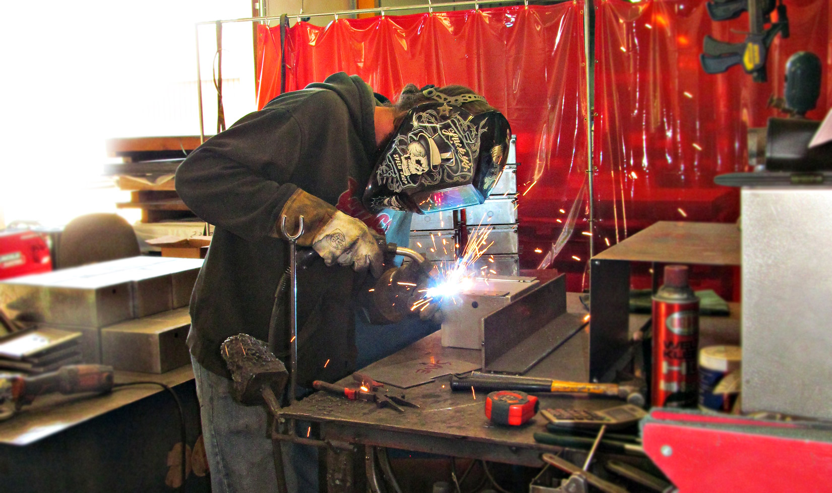 Local welder at Flat To Form Metal Specialties, tac welding a seam onto a metal box